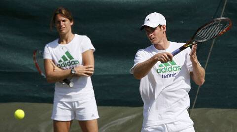 Andy Murray is watched by Amelie Mauresmo, his newly appointed coach, during a training session the day before the start of the Wimbledon Tennis Championships. (Source: Reuters)