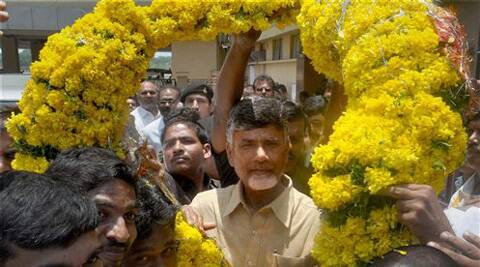 TDP President N Chandrababu Naidu is welcomed on his arrival at Begumpet Airport in Hyderabad on Thursday. Naidu has been elected as the party's leader of Assembly. (Source: PTI)