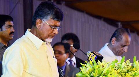 E.S.L. Narasimhan Governor of Andhra Pradesh administrating Oath to N.Chandra Babu Naidu, first Chief Minister of new Andhra Pradesh Nagarjuna Nagar between Vijayawada and Guntur of AP on Sunday. (Source: PTI)