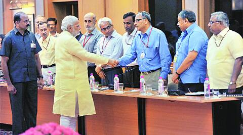 Modi greets secretaries ahead of the meeting, in New Delhi Wednesday. PTI