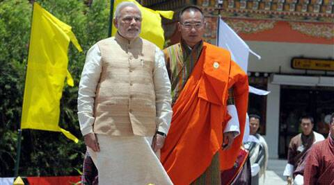 Prime Minister Narendra Modi with his Bhutanese counterpart Tshering Tobgay during a ceremonial welcomed on his arrival at the Paro International Airport in Bhutan on Sunday. (source: PTI)