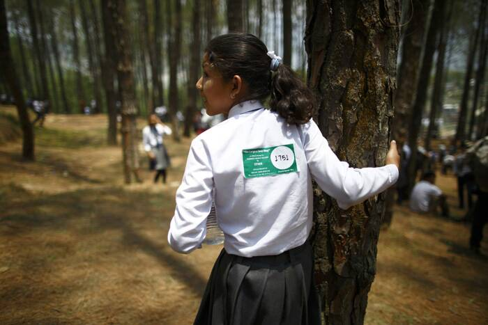 Meanwhile, thousands in Nepal hug trees for world record