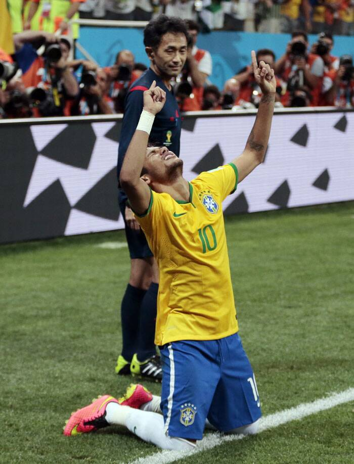 Thanking his stars: Brazil's Neymar after scoring a penalty against Croatia. (Source: AP)