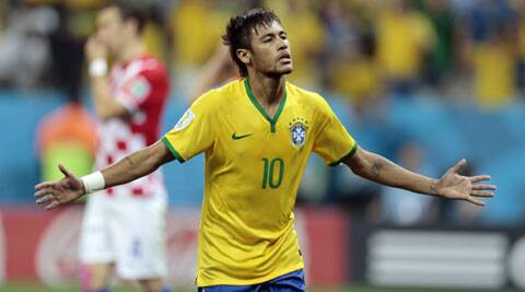 Neymar celebrates his second goal, off a penalty kick, during the Group A match between Brazil and Croatia at the Arena de Sao Paulo on Thursday. (Source: AP)