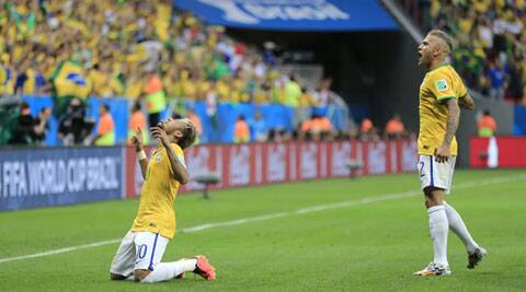 Brazil's Neymar celebrates with Benoit Assou-Ekotto, right, after scoring his side's second goal (Source: AP)