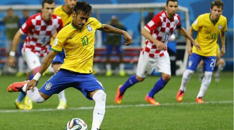 Neymar scores from a penalty kick during Brazil's match against Croatia in Sao Paulo on Thursday. Brazil won the match 3-1. (Source: Reuters)