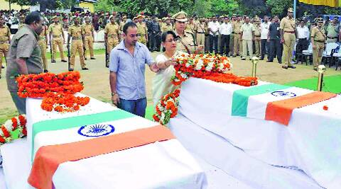Nitya Nanda's wife and son pay floral tribute at 4th APBN in Guwahati on Saturday. (Source: Express photo by Dasarath Deka)
