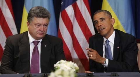 U.S. President Barack Obama, right, meets with Ukraine president-elect Petro Poroshenko in Warsaw, Poland. (AP)