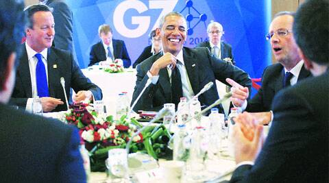 Barack Obama with David Cameron and Francois Hollande at a G7 session in Brussels, Thursday.