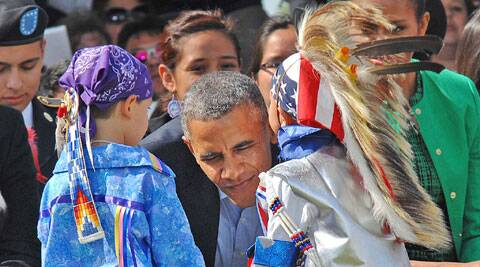 Two young Tiny Tot dancers with US President Barack Obama during his visit to Cannon Ball on Friday. (Source: AP)