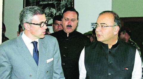 Omar Abdullah with Arun Jaitley in Srinagar, Sunday.(PTI)