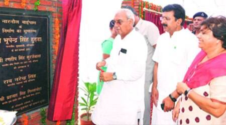 Haryana Chief Minister Bhupinder Singh Hooda lays foundation for Narnaul Bypass Road in Mahendergarh on Friday. Health Minister Rao Narender Singh and CPS Anita Yadav look on.