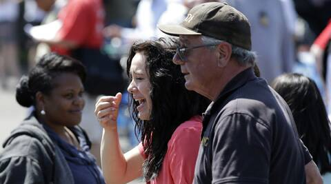 A young girl cries after students arrived after students arrived at a shopping center parking lot in Wood Village, Ore., after a shooting at Reynolds High School Tuesday