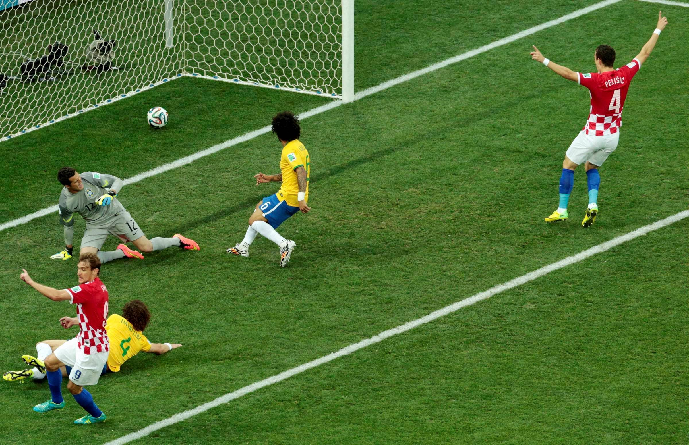 The start could not have been more disastrous for Brazil as Croatia took the lead in the 11th minute, courtesy a own goal by Brazil's Marcelo (C). Croatia's Ivan Perisic (R) celebrates after his team had a 1-0 lead in the Group A encounter. (Source: AP)