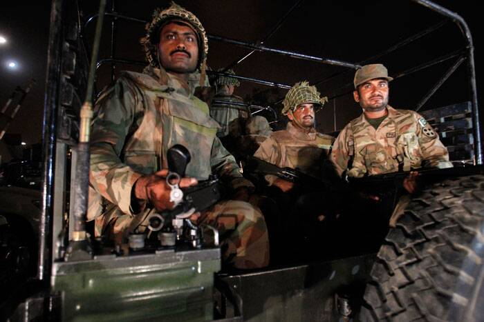 After storming into the airport grounds, gunmen took shelter in two sections of the airport, said senior police officials. <br /><br /> Pakistan army troops arrive at Karachi airport.   (AP)