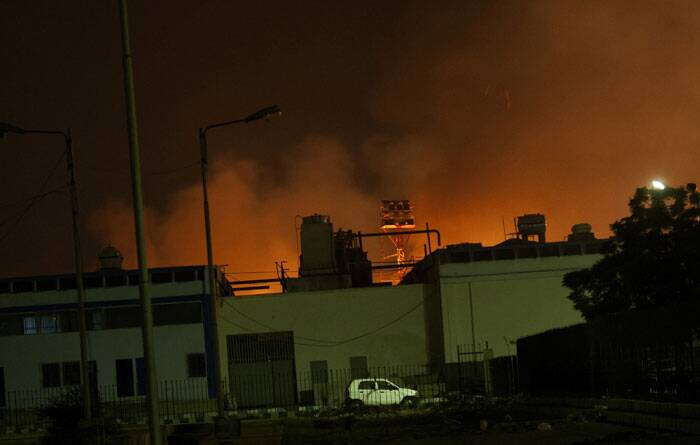 At least 26 persons, including 10 terrorists have been killed when heavily armed militants attacked the Jinnah International Airport's old terminal in Pakistan's financial capital Karachi.<br /><br /> Fire illuminates the sky above Karachi airport terminal. Gunmen stormed the airport terminal used for VIPs and cargo in Pakistan's largest city on Sunday night. (AP)