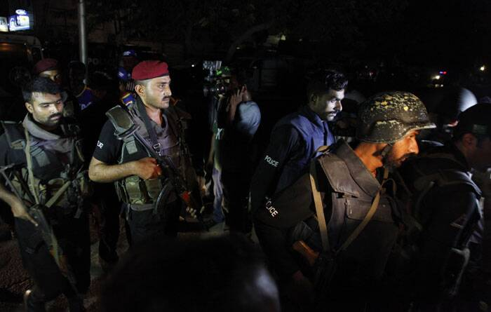 During the course of the attack, heavy gunfire and multiple explosions could be heard coming from the terminal, used for VIP flights and cargo, as militants and security forces battled for control. <br /><br /> Pakistani commandos get ready to enter Karachi airport terminal. (AP)