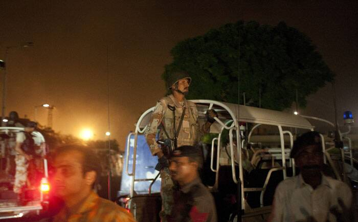 No one immediately claimed responsibility for the attack on the Jinnah International Airport in Karachi, named after the founder of Pakistan. <br /><br /> Pakistani security troops rush to Karachi airport terminal following attacks. (AP)