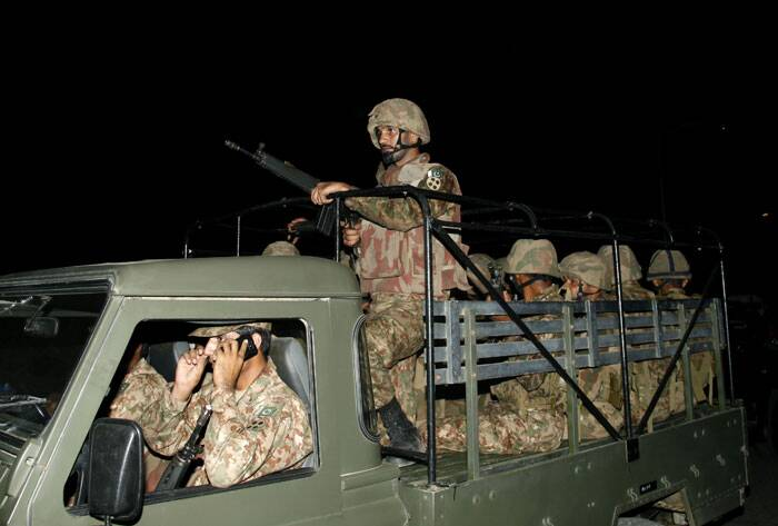 The airport attack began late Sunday and continued on into the dawn hours of Monday in Karachi, a sprawling port city on Pakistan's southern coast, although officials said all the passengers had been evacuated.<br /><br /> Pakistani troops arrive at Jinnah International Airport. (AP)