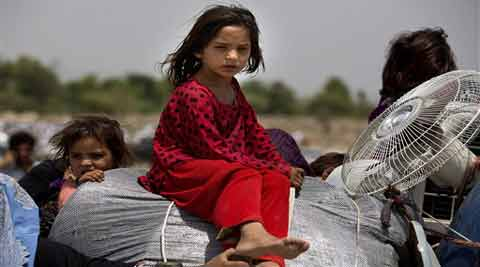 Pakistani tribal people arrive in Bannu, Pakistan. (Source: AP)