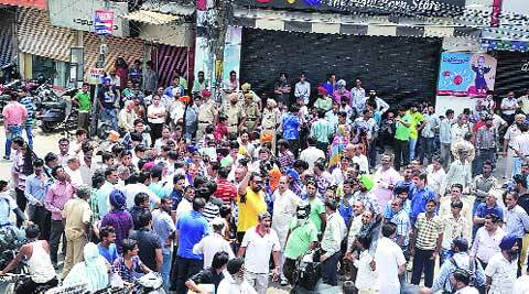 Shopkeepers during the protest at the Ghumar Mandi Chowk in Ludhiana on Monday. (source: Express photo by Gurmeet Singh)
