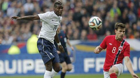 Paul Pogba (L) kicks the ball next to Havard Nordtveit of Norway during their international friendly. (Source: AP)