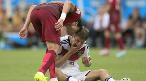 Portugal's Pepe (L) headbutts Germany's Thomas Mueller during the group G World Cup match. (Source: AP)