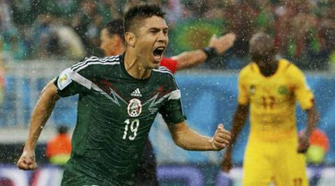 Mexico's Oribe Peralta celebrates his goal against Cameroon during their 2014 World Cup Group A soccer match at the Dunas arena in Natal (Source: Reuters)