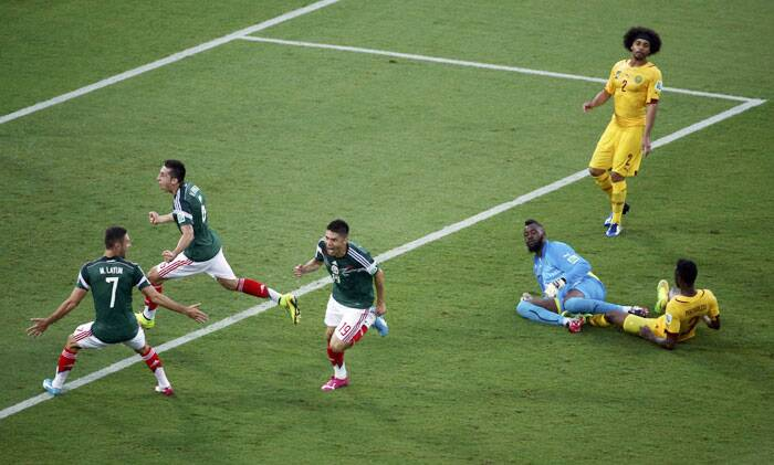 The deadlock was broken by Mexico's Peralta in the 61st minute when he easily put the ball over the goal line. Santos took the first hit which was saved by the Cameroon goal-kepeer Itandje but Peralta had the rebound covered to give Mexico the lead. (Source: Reuters)