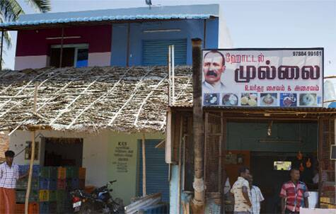 A shop in the region with Pennycuick's face on its hoarding Photos: Jyothy Karat