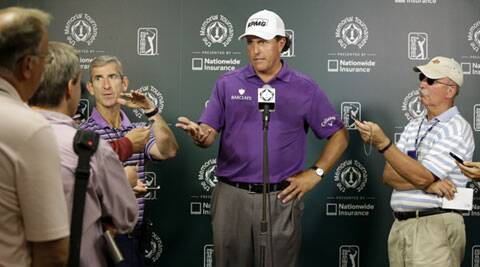Phil Mickelson responds to a question during a news conference following the third round of the Memorial golf tournament in Dublin, Ohio. (Source: AP)