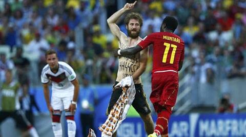 """Messages written on the pitch invader's chest and back included """"HH"""", signifying Heil Hitler, and """"SS,"""" referring to the Nazi paramilitary unit. (Source: Reuters)"""