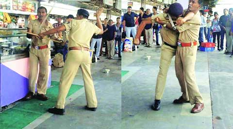 Policemen clash with each other at Ahmedabad railway station on Monday. (Source: PTI)