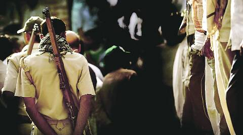 Police in the village on Tuesday.PRAVEEN KHANNA