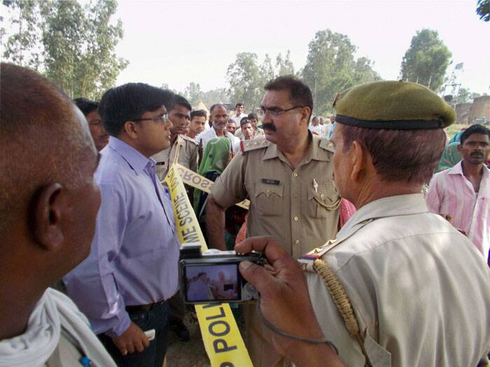 Police and officials inspect the spot where the body of the girl was found. (Source: Express photo by Oinam Anand)