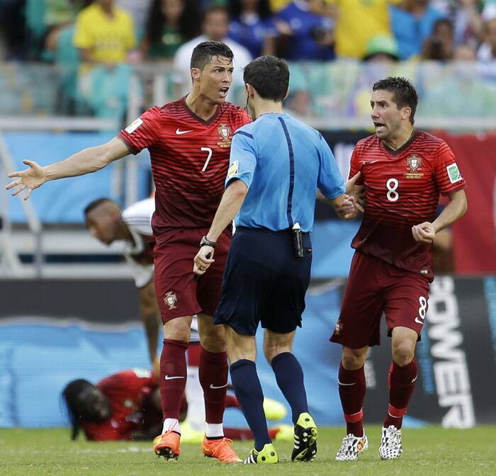 Portugal's Cristiano Ronaldo and Joao Moutinho argue with the referee over a penalty. (Source: AP)