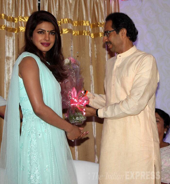 "Udhav Thackery hands over a bouquet to Priyanka.  <br /><br /> Priyanka further said: ""It means a lot to me. My dad was someone who has touched many hearts through his work. Today, seeing this road named after him, people ask that just because he is Priyanka Chopra's father…is this road being named after him?' No, it's not that."" (Source: Varinder Chawla)"