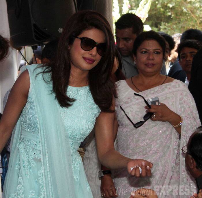 Both Priyanka and her mother sported dark glasses as they arrived to the inauguration of the street. (Source: Varinder Chawla)