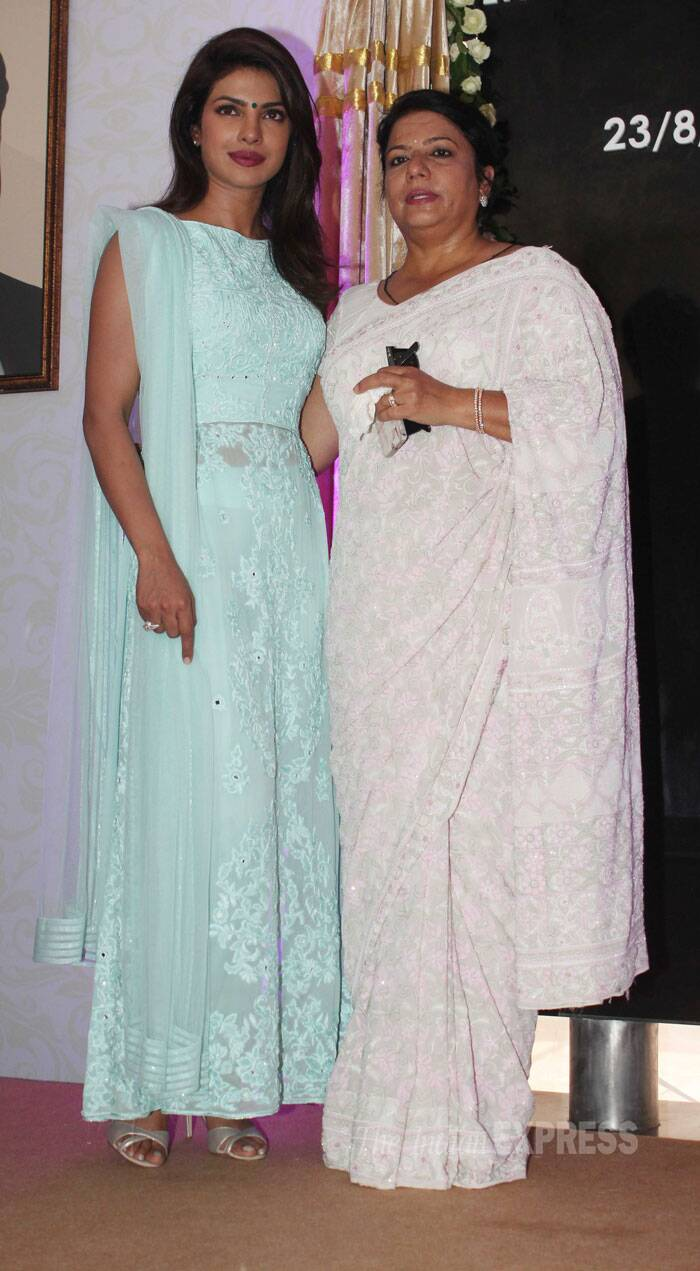 Actress Priyanka Chopra stood tall along with her mother Madhu Chopra on the first death anniversary of her late father, Ashok Chopra. Priyanka's father passed away last year after a battle with cancer. <br /><br /> Priyanka along with Shiv Sena Udhav Thackeray unveiled a street that has been named as 'Lieutenant Colonel Dr. Ashok Chopra Marg' in the city. (Source: Varinder Chawla)