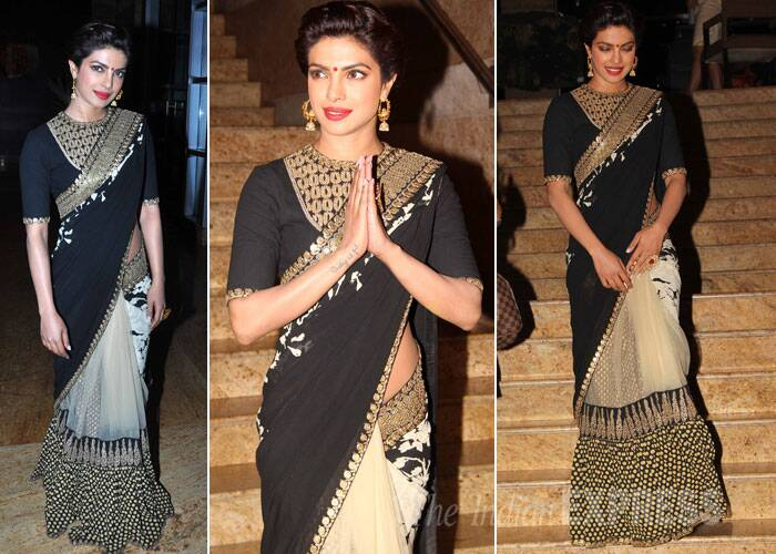 Priyanka Chopra, who recently returned to Mumbai from her 'Dil Dhadakne Do' shoot, was gorgeous in a gold and black Sabyasachi sari with Amrapali jewellery. (Source: Varinder Chawla)