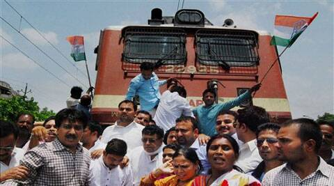Congress activists block a train passage while protesting against hike in the Railway fares in Bhopal. (Source: AP)