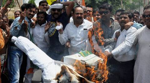 Congress supporters protesting the proposed hike in railway fares in front of Vidhan Sabha in Lucknow. (Source: PTI)