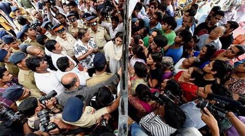 Campa Cola residents block the entrance for the BMC officials who arrived to disconnect the water and electricity supply of the society, in Mumbai on Saturday. (Source: PTI)