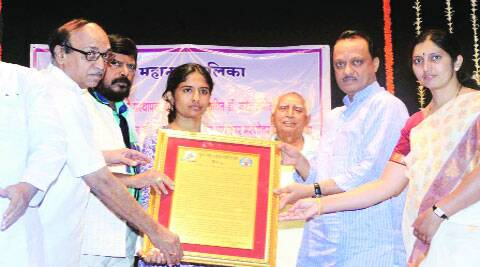 Pawar with Mukta, daughter of slain anti-superstition activist Narendra Dabholkar, at a function in the city