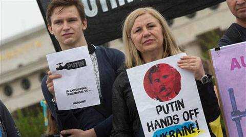 Demonstrators protest against Russian President Vladimir Putin on occasion of his visit to Austrian President Heinz Fischer in front of Vienna's historic Hofburg palace Tuesday. (Source: AP)