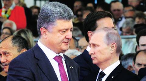 Ukraine's President-elect Petro Poroshenko (left) next to Russian President Vladimir Putin in Ouistreham on Friday. (Source:AP)