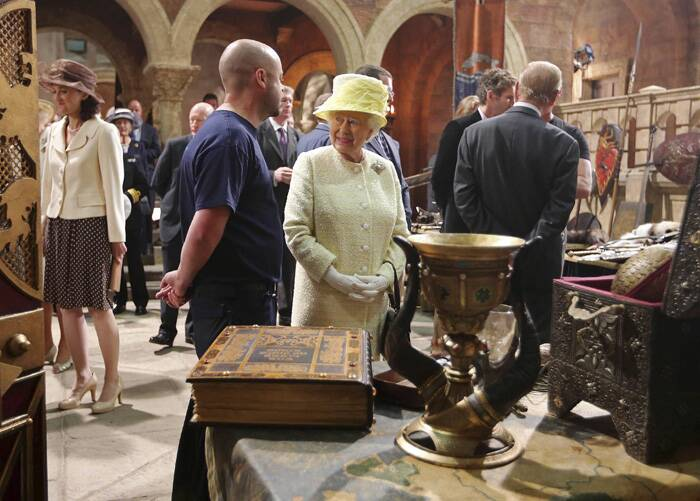 The Queen and Prince Philip also viewed some of the props that have featured in the hit fantasy show, which wrapped up its fourth season recently.<br /><br />Queen Elizabeth talks to an unidentified guest as she looks at props on the sets of Game of Thrones. (Source: Reuters)