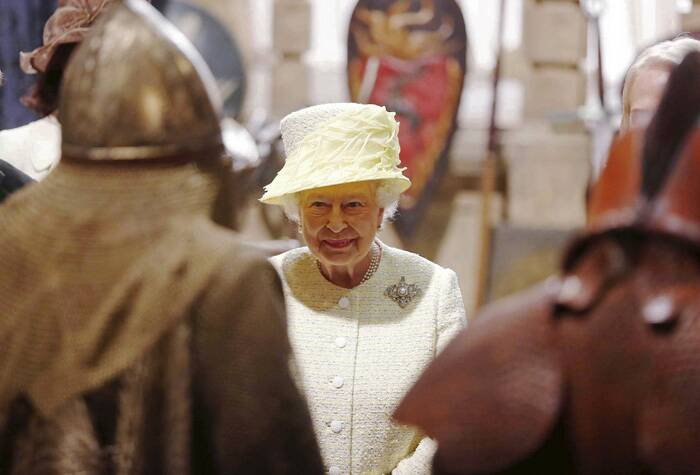 Queen Elizabeth looks at costumes and props on the sets of Game of Thrones. (Source: Reuters)-