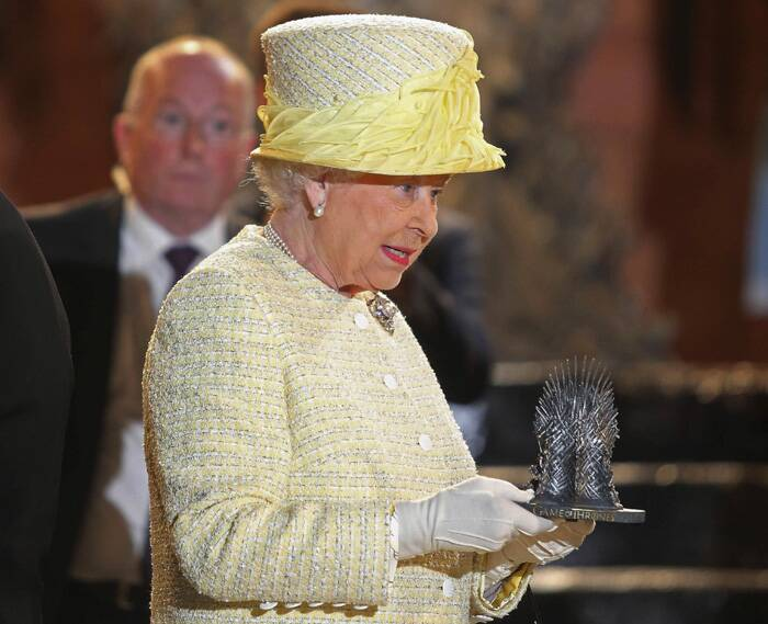 Before leaving, they were presented with a miniature version of the infamous Iron Throne that appears in the series, based on JRR Martin's books.<br /><br />Queen Elizabeth holds a miniature Iron Throne. (Source: Reuters)