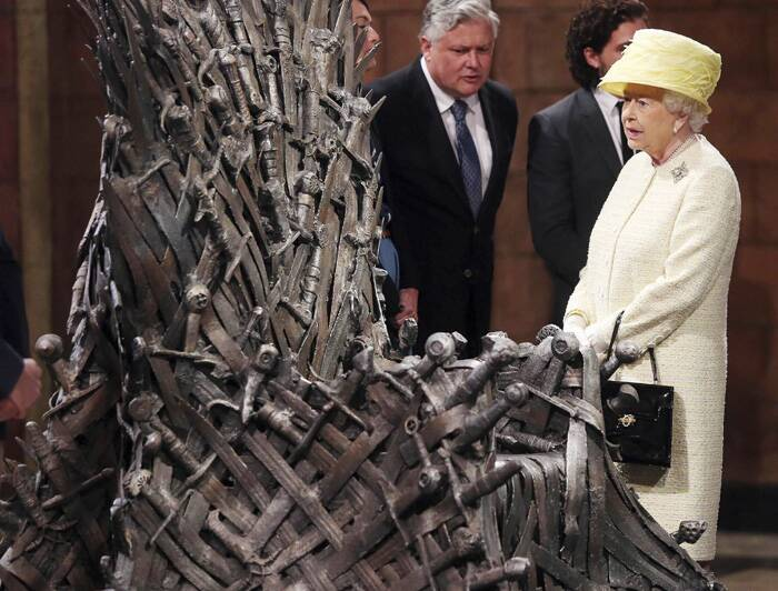 Queen Elizabeth II and the Duke of Edinburgh met cast and production members of HBO's hit TV show 'Game of Thrones' during a tour of their set in Belfast, Northern Ireland.<br /><br />Queen Elizabeth looks at the Iron Throne next to Game of Thrones cast members Kit Harington (2nd R), Conleth Hill (C) and Lena Headey (L). (Source: Reuters)